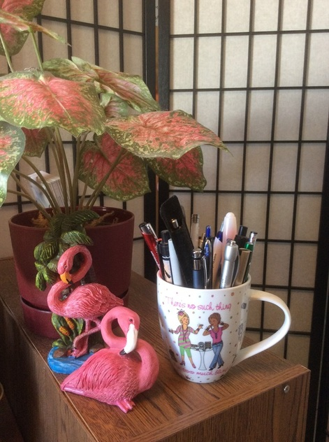 Flamingo figurines, and mug designed by Wendy Dewar Hughes.