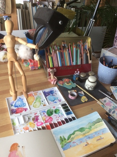 Watercolor artist's table and paints.