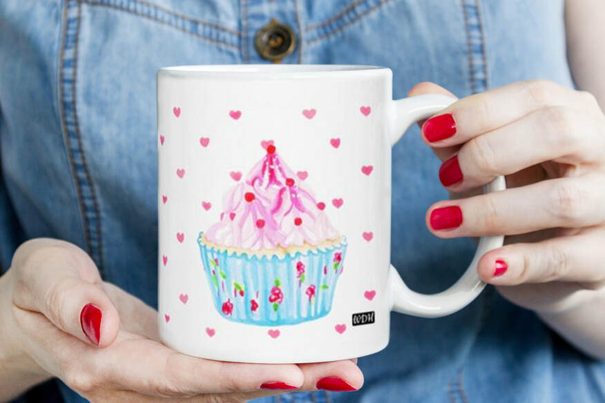 Hands holding Hey Cupcake mug by Wendy Dewar Hughes.