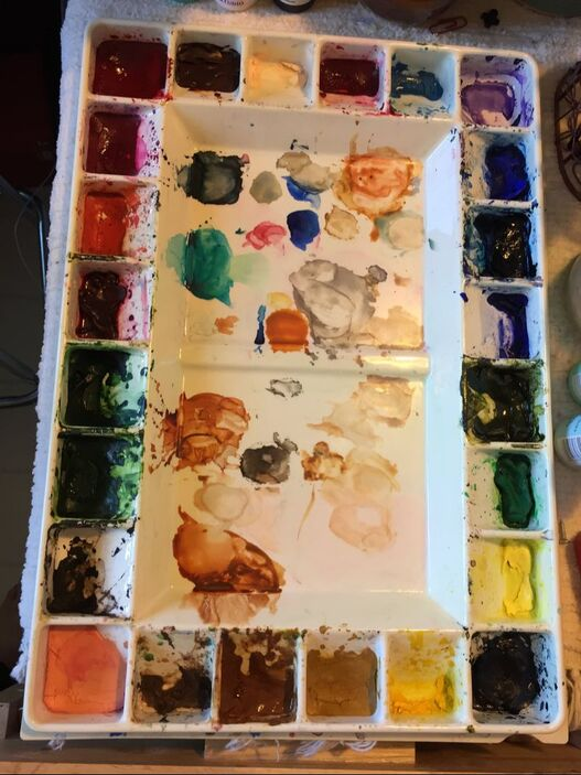 Artist's large watercolor palette using tube paints.