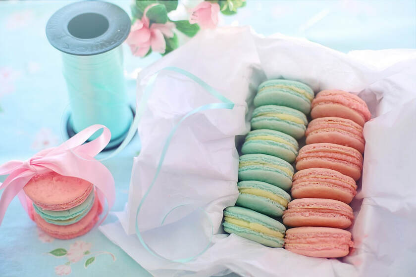 Pink and mint macarons with pretty aqua and pink ribbon.
