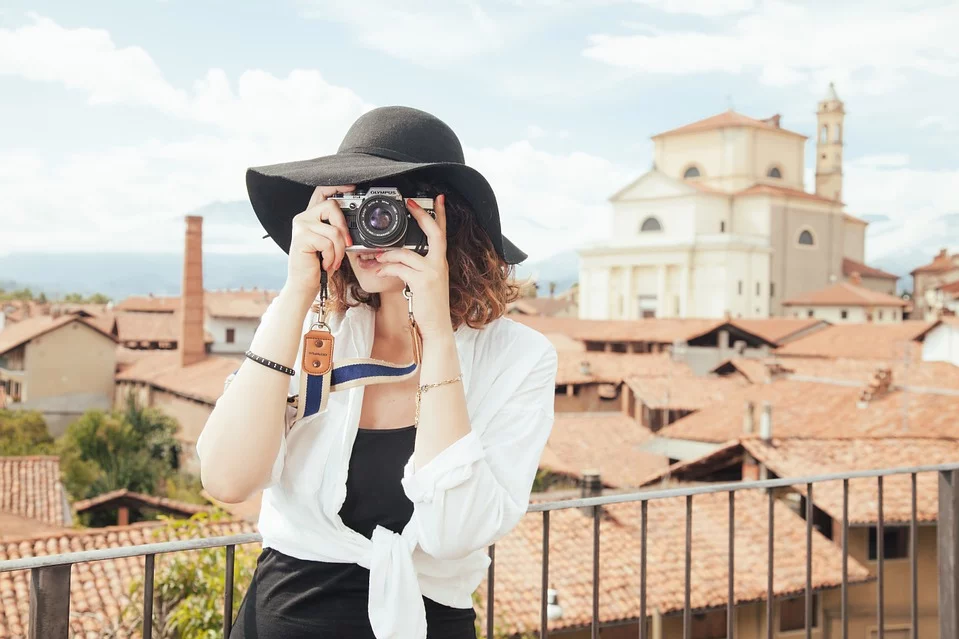 Fearless woman traveller with camera in Italy.